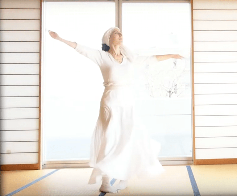 woman dancing with white cloth