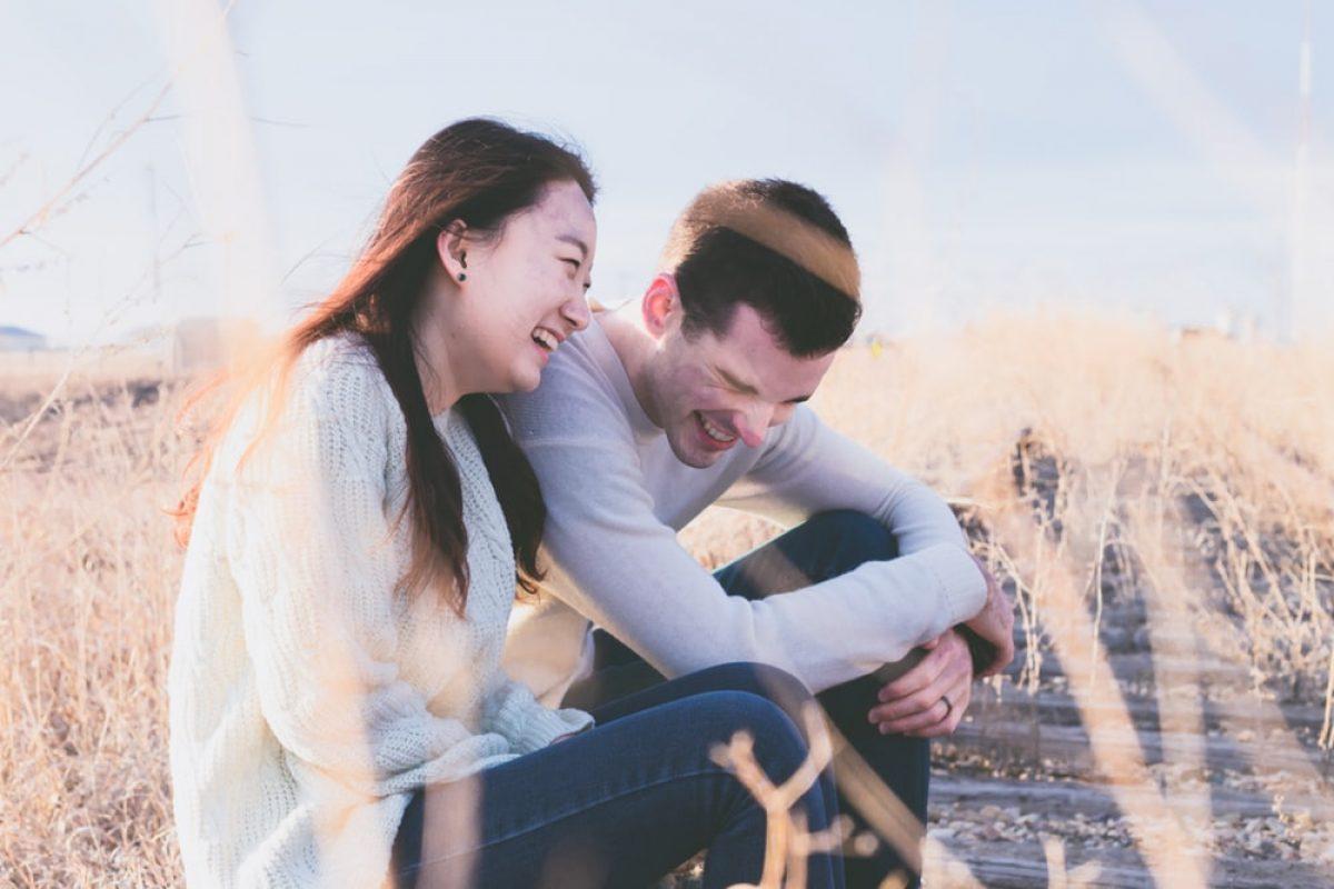mix couple who laugh